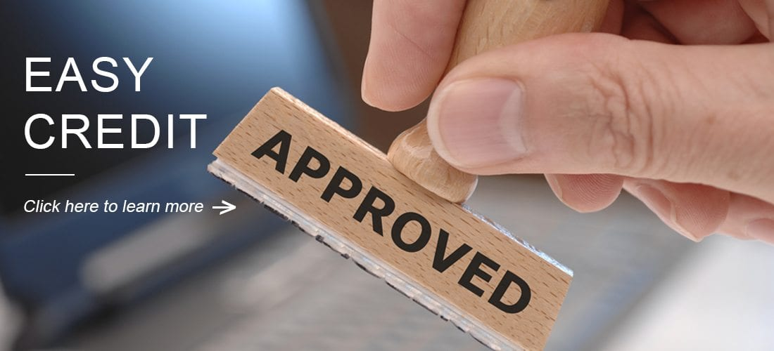 Image of a stamp that says approved for the credit slider image