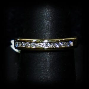Image of a simple diamond wedding ring on the jewelry store OKC page