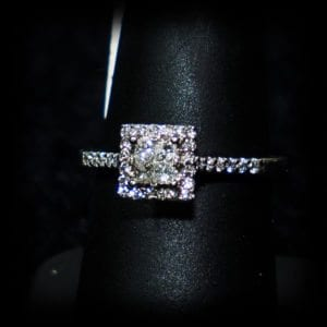 Image of a square diamond ring with diamonds on the band on the jewelry store OKC page