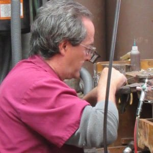 Image of a jewelry repair technician repairing jewelry in OKC