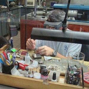 Image of a jewelry repair technician repairing jewelry in OKC 2
