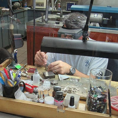 Image of a jewelry repair technician repairing jewelry in OKC 2